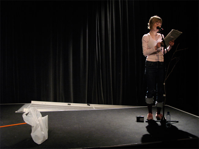 Essi Kausalainen: Artist Statement, performance at Supermarket Talks (Assistants: Kaarina Ormio, Kjell Hansson, Image: Mikko Kuorinki)